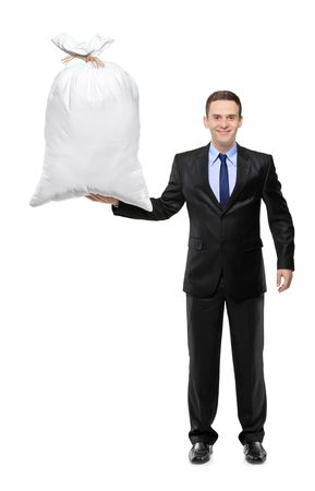 Full length portrait of a happy businessman holding a money bag isolated on white background Stock Photo - 8100123