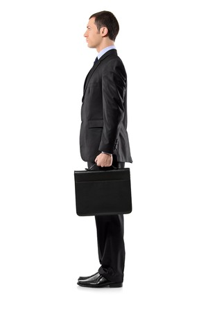 Full length portrait of a businessman holding a leather briefcase waiting in line isolated against white background photo