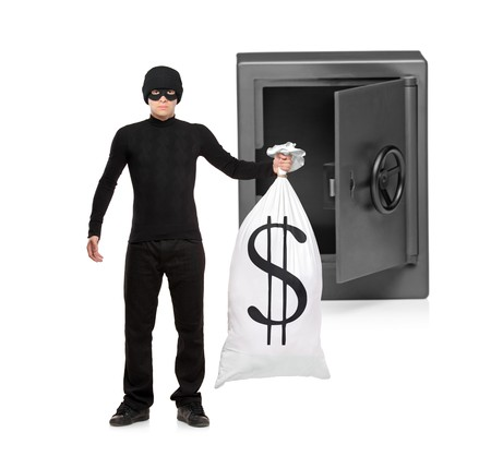Full length portrait of a thief stealing a money bag from a deposit safe isolated on white background Stock Photo - 8100168