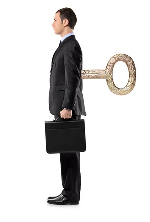 Full length portrait of a businessman with wind-up key in his back isolated against white background Stock Photo - 8189570