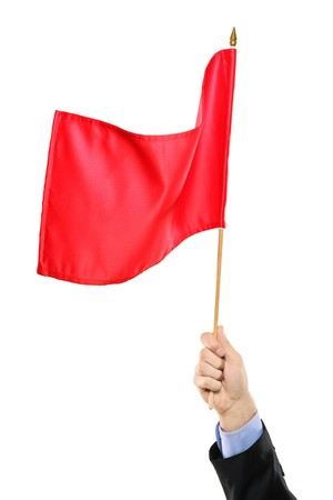 Hand waving a red flag isolated on white background Stock Photo - 8189569