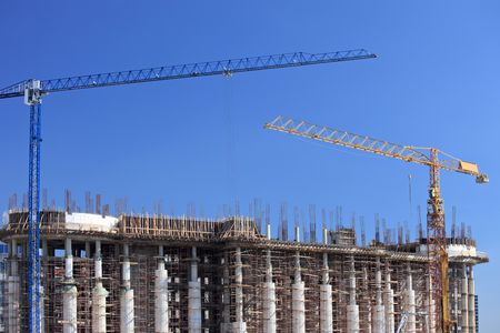 Construction site with cranes over a building in Skopje, Macedonia photo