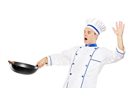 A surprised chef holding a wok isolated against white background photo