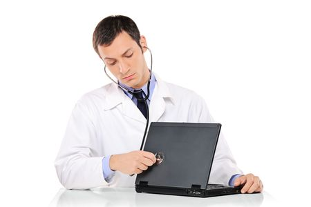 PC doctor examining a laptop computer against white background Stock Photo - 8191704