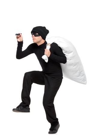 shoplifter: Full length portait of a robber with a bag and flashlight in hands isolated against white background