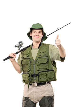 A fisherman giving thumbs up, with fishing pole on his shoulder isolated against white background photo