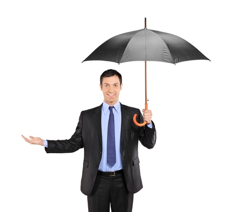 protect: A man holding an umbrella and gesturing isolated on white background Stock Photo
