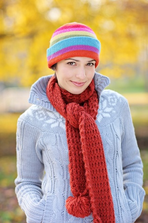 scarf: A view of a beautiful young woman in autumn park Stock Photo
