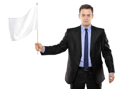 defeat: Sad man holding a white flag, gesturing defeat, isolated on white background Stock Photo