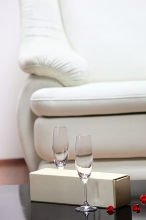 A studio shot of a detail of white leather sofa in a living room photo