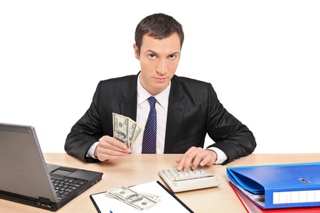 A view of a businessman counting money in his office isolated on white background photo