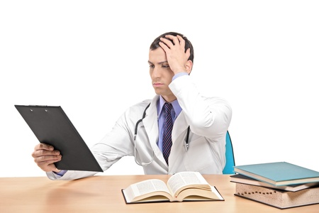 malpractice: A view of a doctor banging his head realizing a mistake isolated on white background