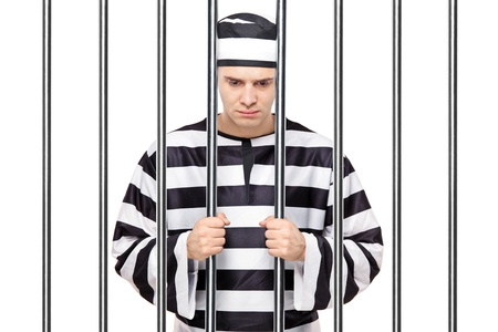 prisoner man: A view of a sad prisoner in jail holding bars isolated on white background