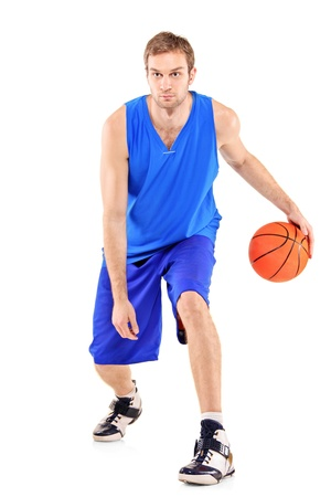 Full length portrait of a basketball player with basketball isolated on white background photo