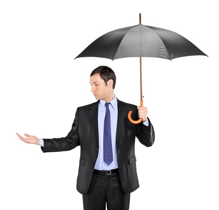 A man holding an umbrella and checking for rain isolated on white background Stock Photo - 8379734