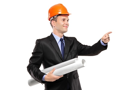 A view of an architect with blueprints pointing isolated against white background Stock Photo - 8379731