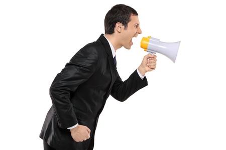 empresario enojado: Empresario enojado gritando a trav�s de la megafon�a aislado sobre fondo blanco
