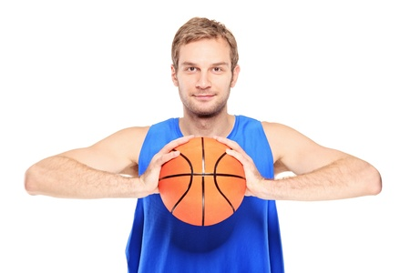 sportsmen: Young basketball player posing with a basketball isolated on white background Stock Photo