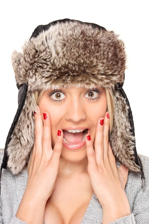 Close-up of a young woman wearing fur hat looking very surprised isolated on white background Stock Photo - 8379771