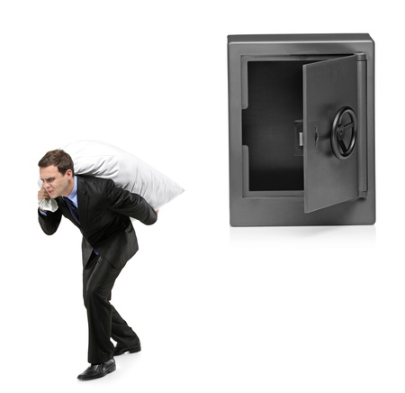 Full length portrait of a man stealing a money bag from a deposit safe isolated on white background Stock Photo - 8379766