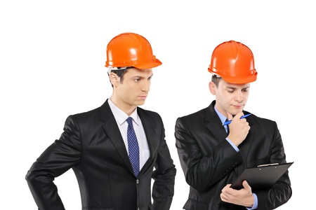 Two architects in black suit wearing helmet in thoughts isolated on white background photo