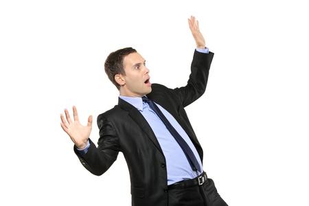 Angst: Ein Blick auf eine schockiert young Businessman isoliert auf wei�em Hintergrund Lizenzfreie Bilder