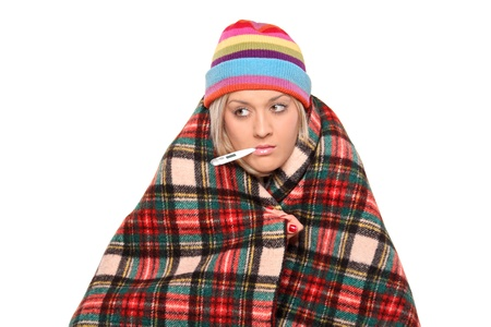 grippe: Ill woman with thermometer in her mouth isolated on white background Stock Photo