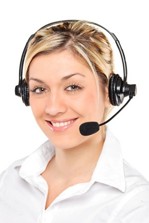 Portrait of a young female customer service operator wearing a headset isolated on white background photo