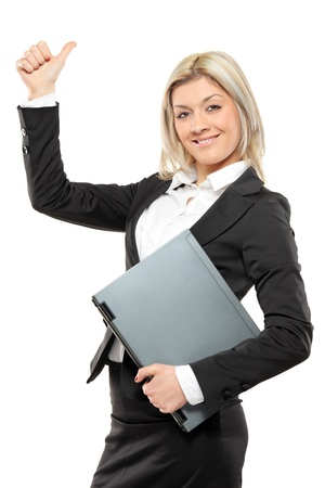 A portrait of a happy businesswoman holding a laptop and giving thumbs up isolated on white background Stock Photo - 8460723