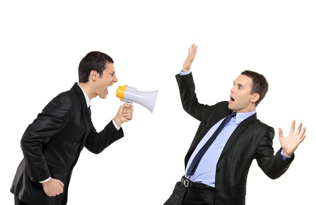 Angry businessman yelling via megaphone to another businessman isolated against white background Stock Photo - 8458996