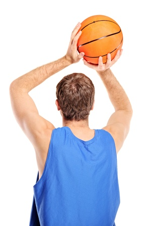 Basketball player aiming to shoot a ball isolated on white background photo