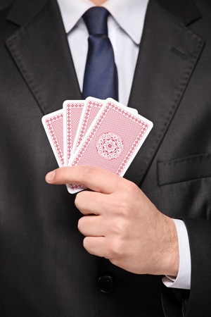 A close up of a man holding a four cards playing poker photo