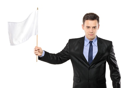A sad man holding a white flag, gesturing defeat, isolated on white background Stock Photo - 8471816