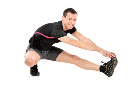 Full length portrait of a young athlete exercising isolated against white background photo