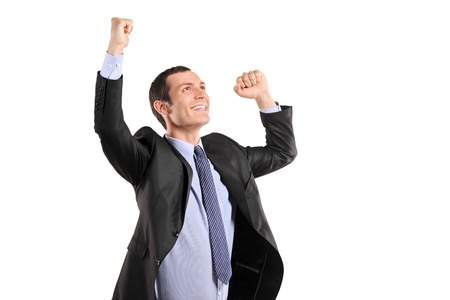 victorious: Portrait of a young happy businessman with raised hands isolated on white background Stock Photo