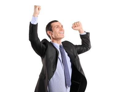 excitment: Retrato de un joven empresario feliz con las manos levantadas aislados sobre fondo blanco