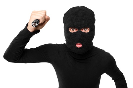 A close up of a robber with robbery mask holding a flashlight isolated against white background Stock Photo - 8471813