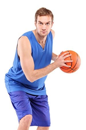 hand baskets: A basketball player posing with a ball isolated against white background