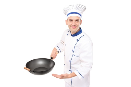 A chef holding a wok welcoming isolated against white background photo