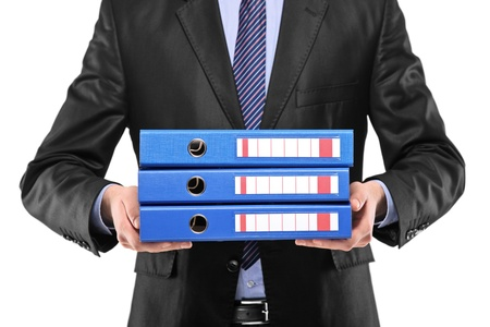 A close up of a businessman holding three blue folders isolated on white background photo