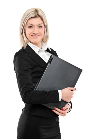A portrait of a beautiful businesswoman holding a laptop isolated on white background photo