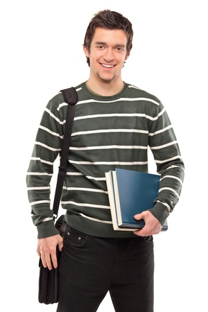 A student with a school bag holding books isolated on white background