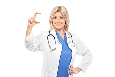 Female medical doctor holding a bottle of prescription drugs isolated on white background photo