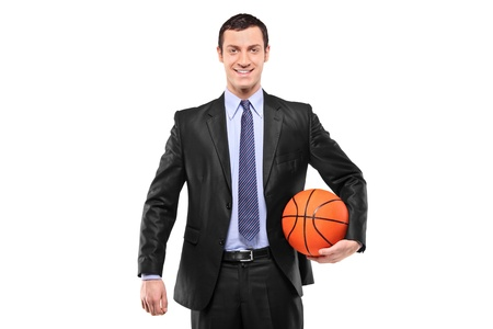 Smiling businessman holding a basketball isolated against white background Stock Photo - 8505743