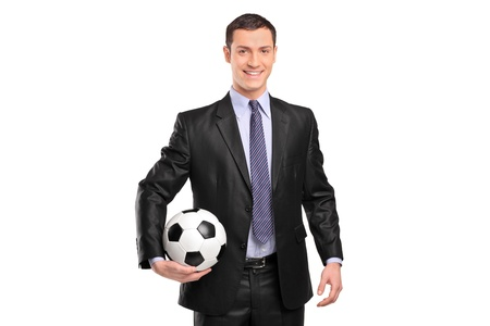 Smiling businessman holding a football isolated on white background photo