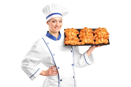 A female baker holding croissants isolated on white background Stock Photo - 8534758