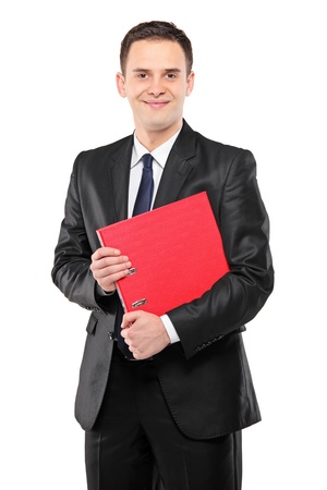 fascicule: A happy businessperson holding a red folder with documents isolated on white background