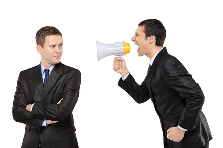 Angry businessman yelling via megaphone to another man isolated on white background Stock Photo - 8555126