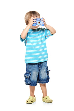 Full length portrait of a little boy taking pictures with a camera isolated against white background Stock Photo - 8537714