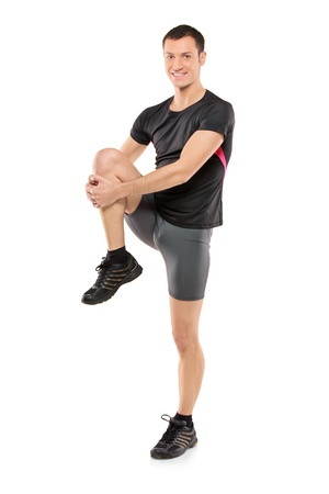sport wear: Full length portrait of a young athlete exercising isolated on white background